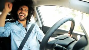 stock-footage-man-singing-and-dancing-happy-driving-car-in-city